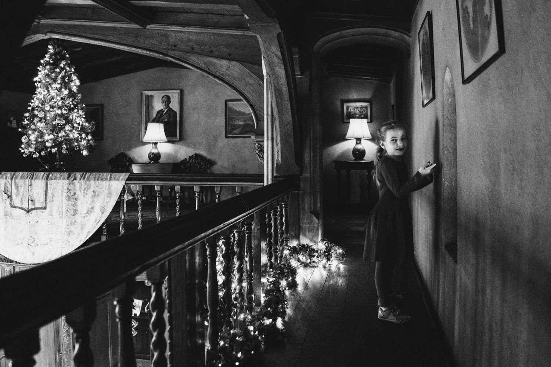 A little girl explores a balcony at Coe House.