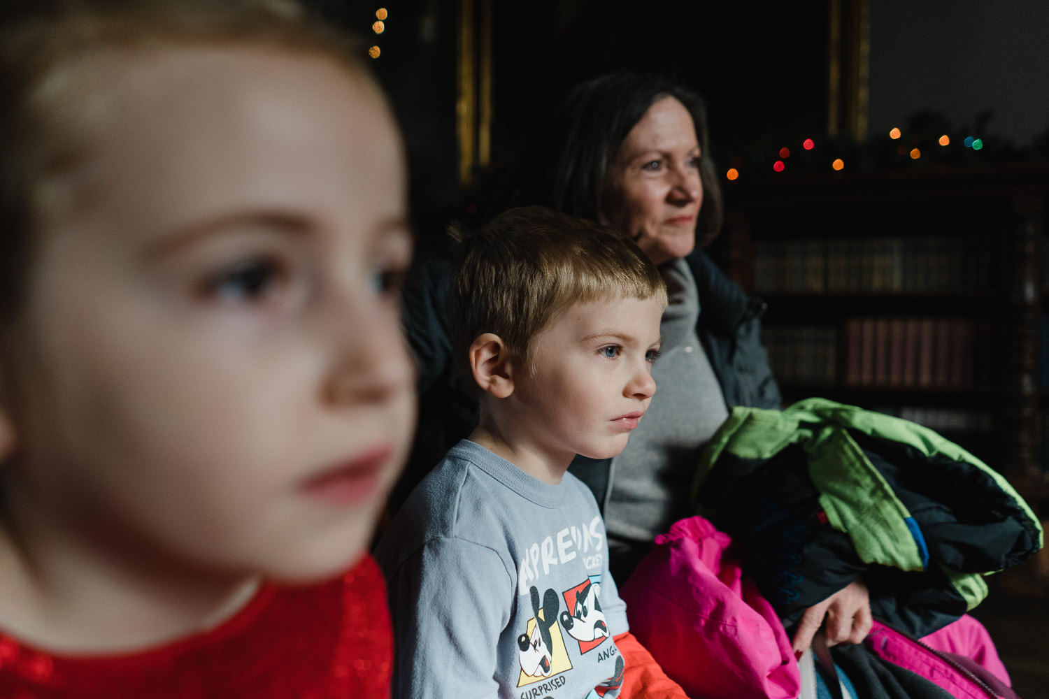 A family watched a pianist at Coe House.