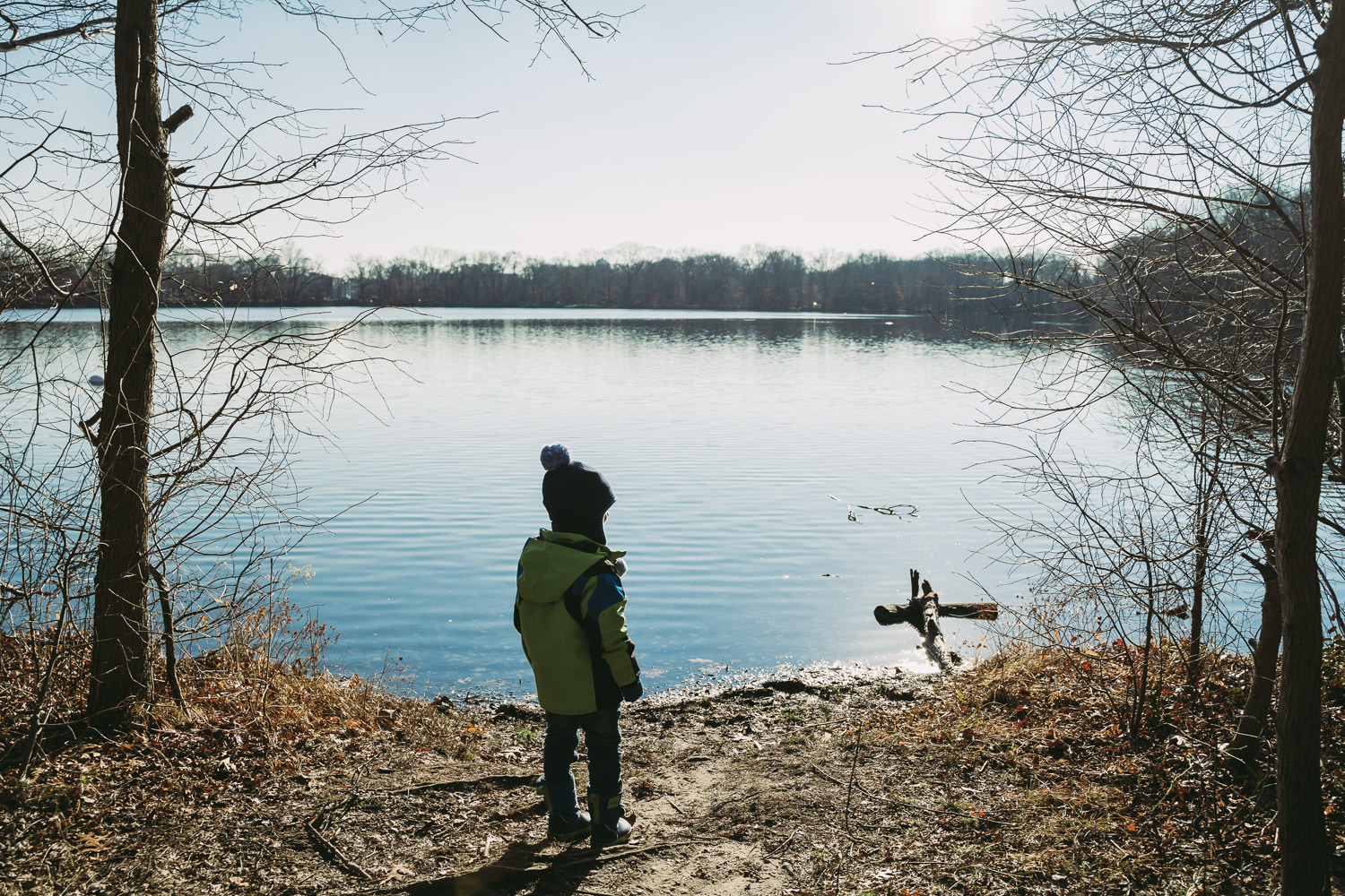 A little boy looks out at Hempstead Lake.