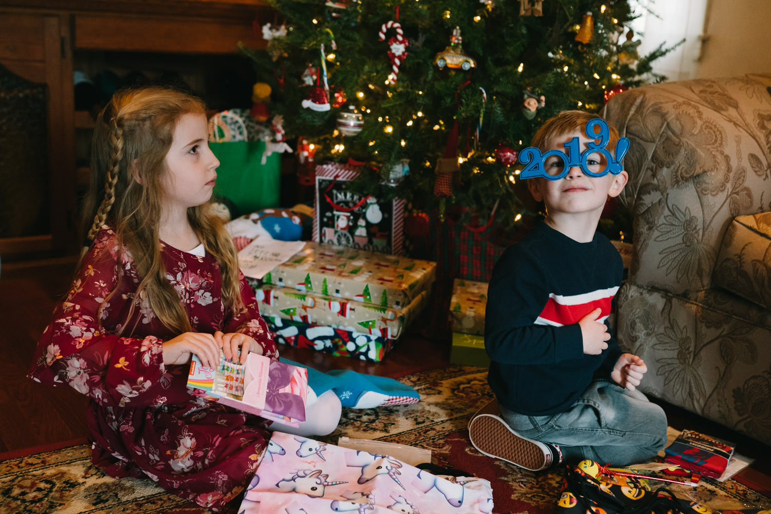 Children open gifts on Christmas eve.