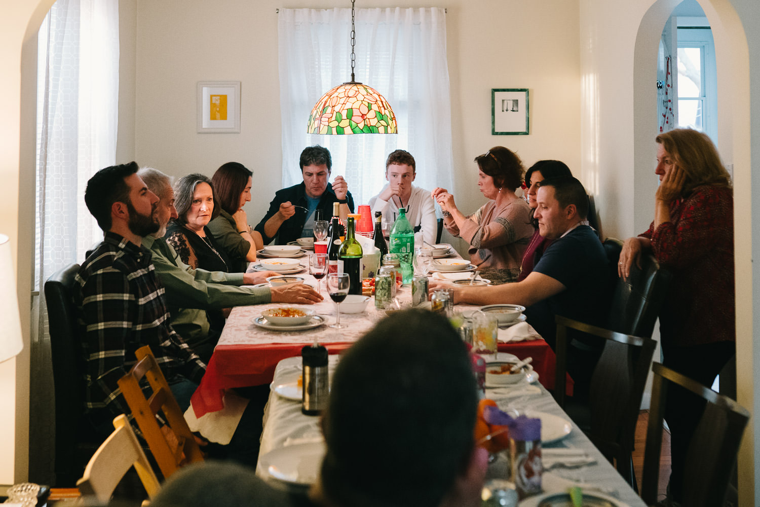 Family sits down for Christmas dinner.
