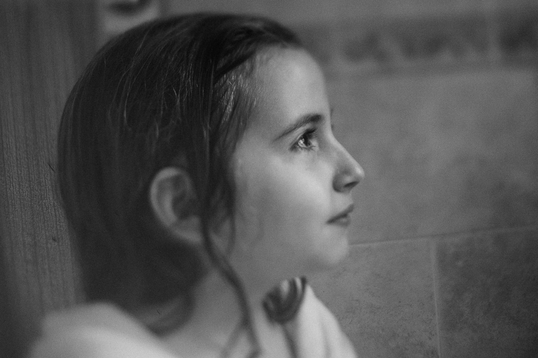 A portrait of a little girl after a bath.