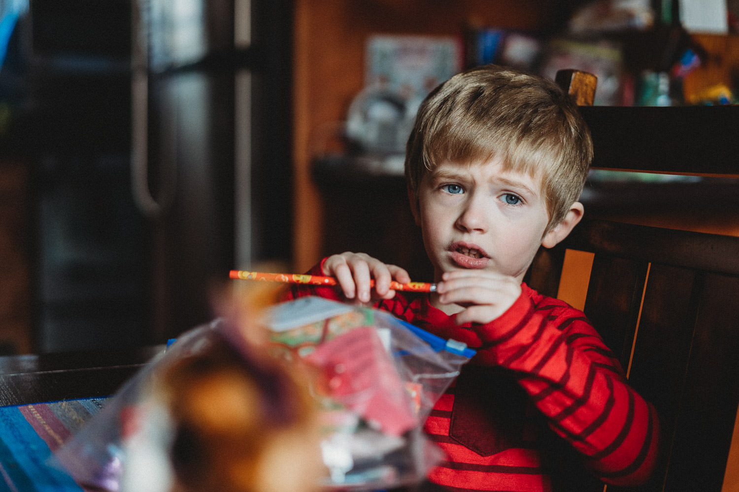 A little boy goes through his Valentines' treats.