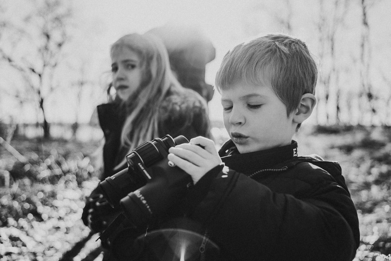 A little boy bird-watches at Garvies Point Preserve.