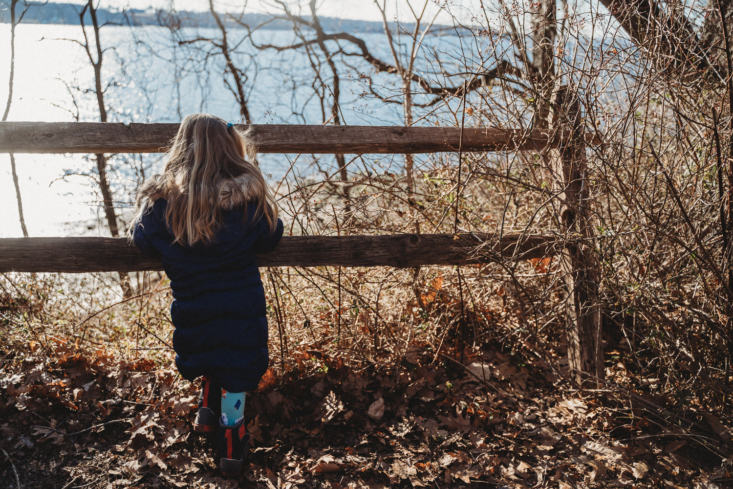 A little girl looks out at the Long Island Sound from Garvies Point Preserve.