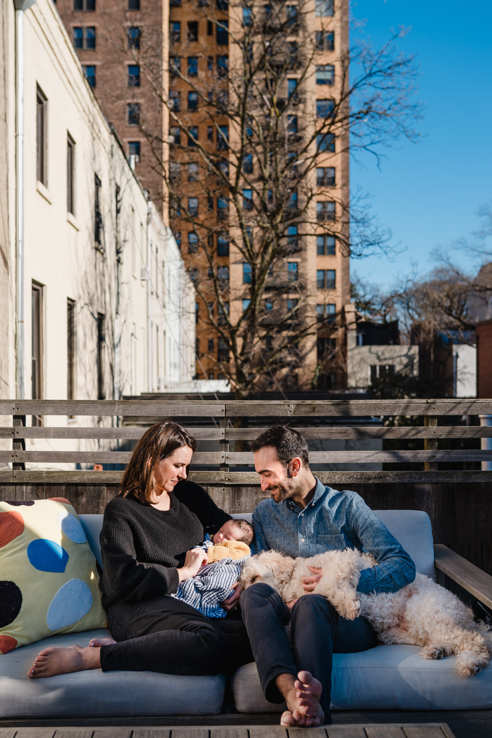 A family relaxes on their roof deck.