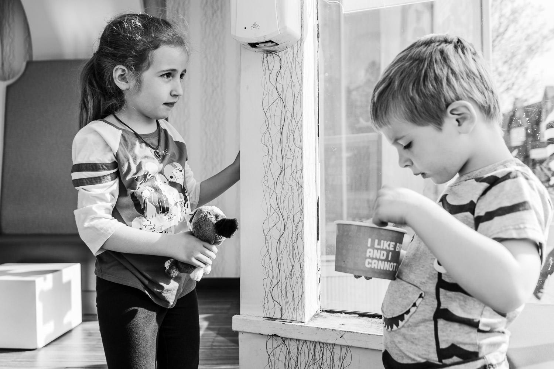 Two children eat frozen yogurt at 16 Handles.
