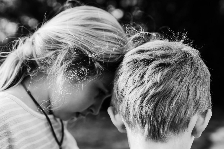 Two children huddle together.