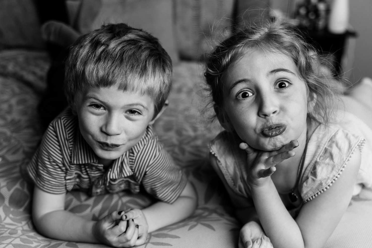 Two children make goofy faces at the camera.