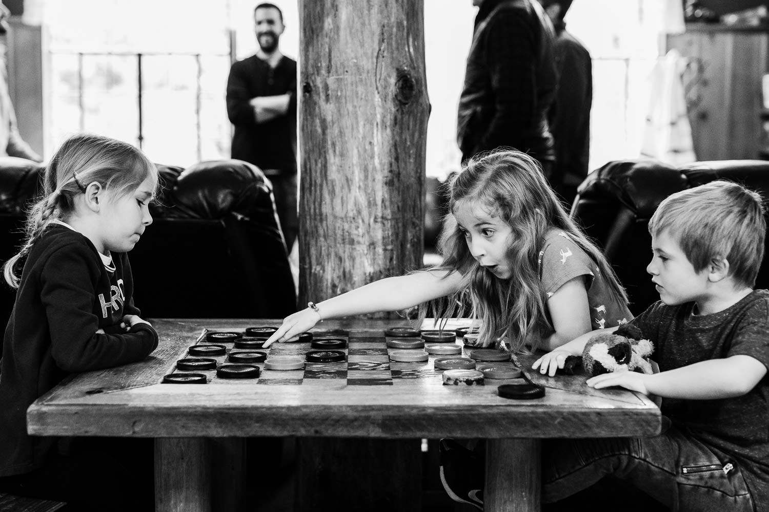 Children play checkers at Strawberry Lodge.