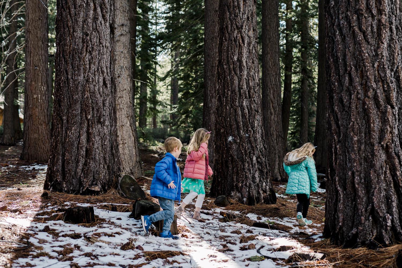 Children run through the snow in South Lake Tahoe.