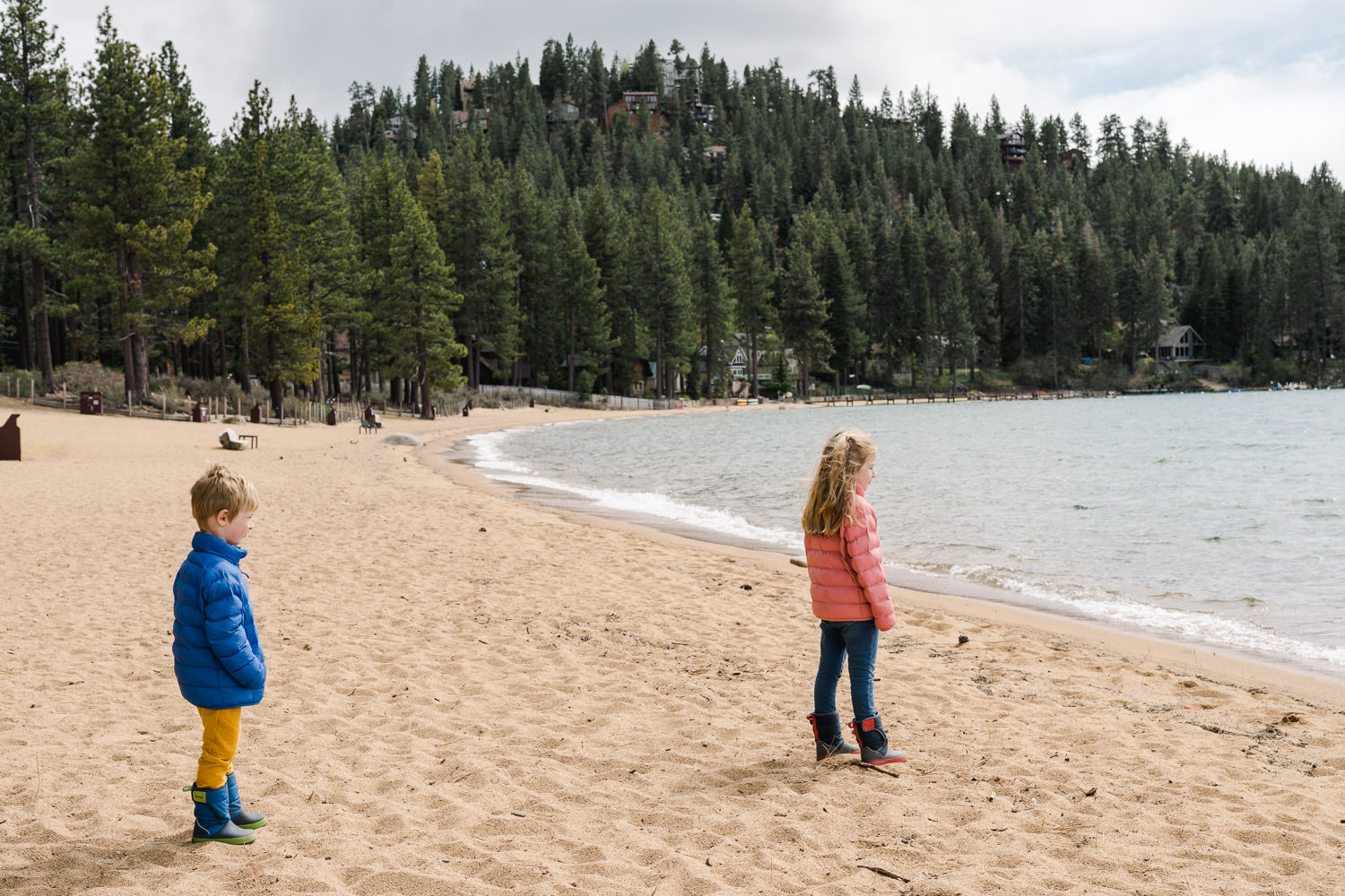 Two children look out at Lake Tahoe.