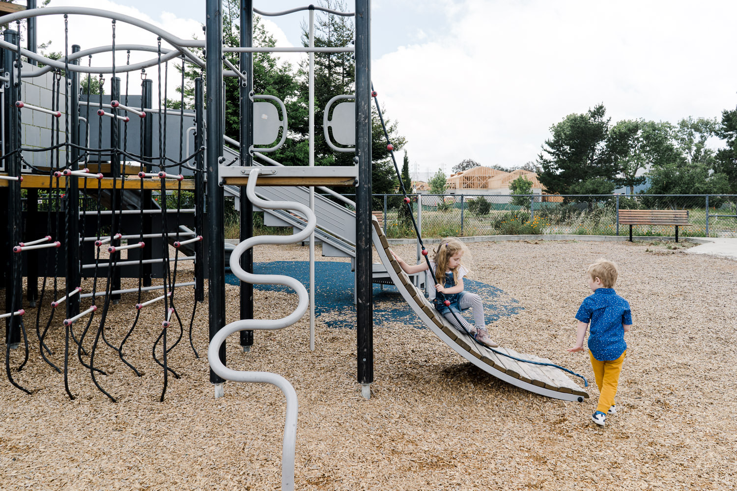 Two children play on a playground.