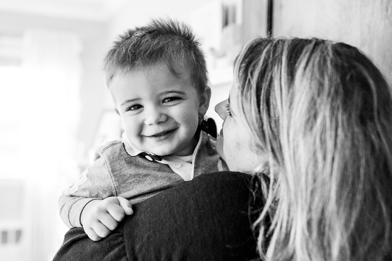 A woman holds a toddler boy.