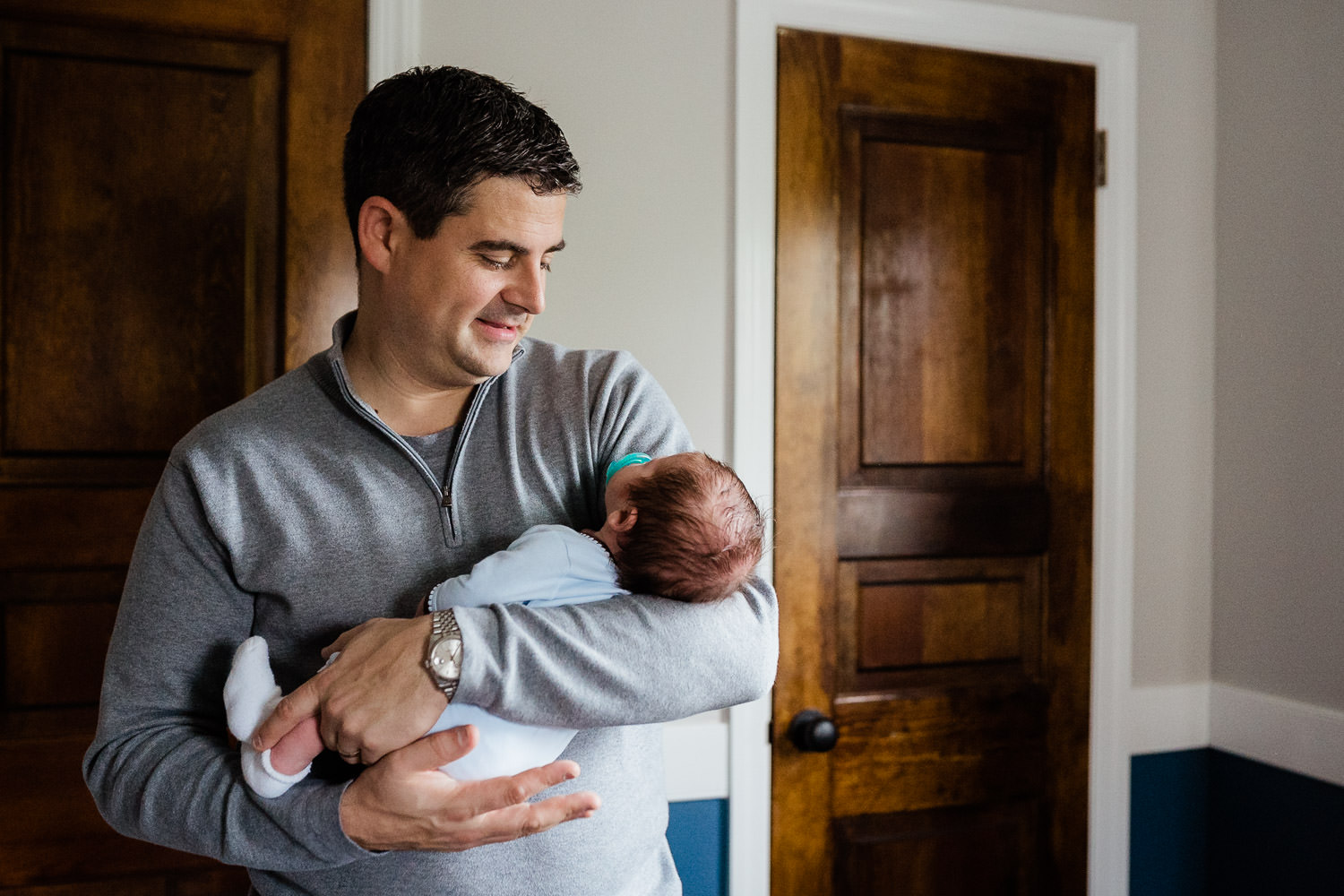 A father holds his newborn baby.