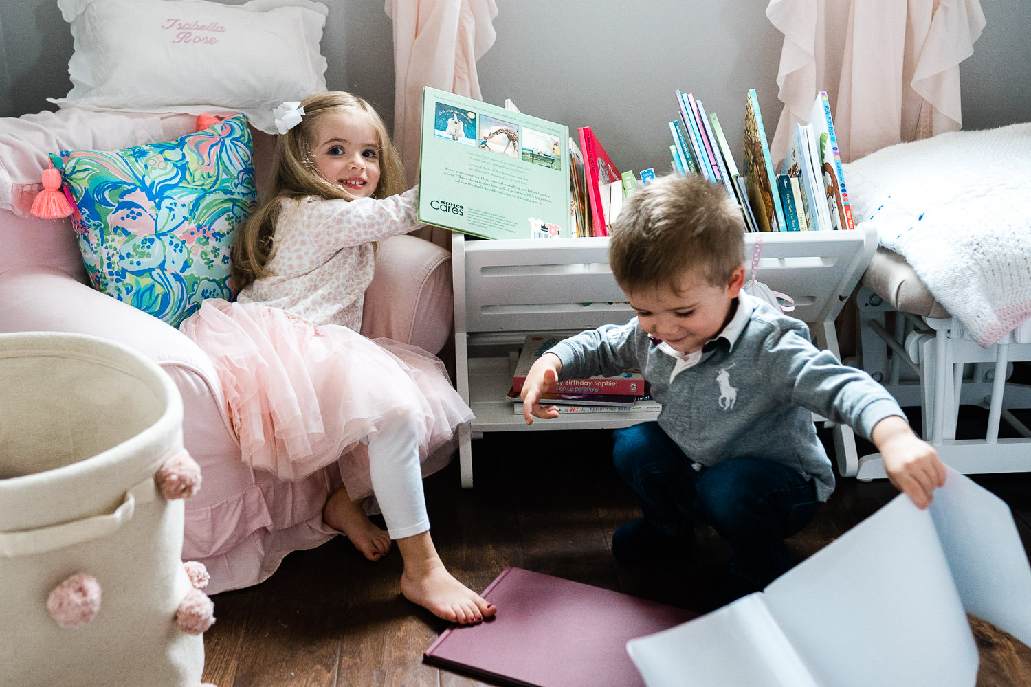 Two children play in their bedroom.
