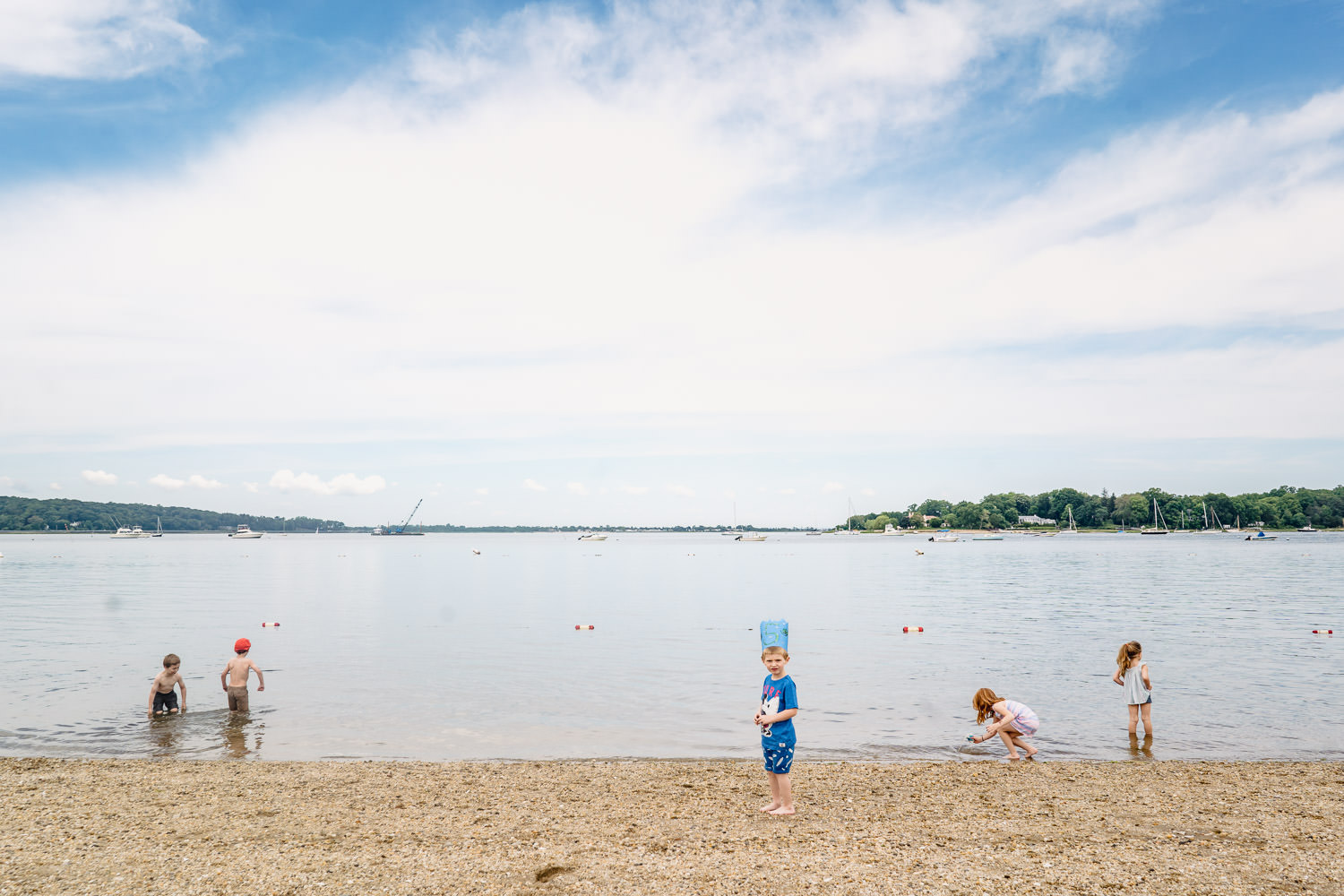 Children on the beach at Oyster Bay.