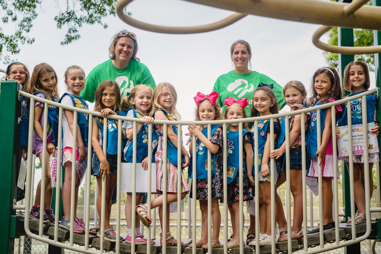 Girl scouts line up on a bridge at Garden City South Park.
