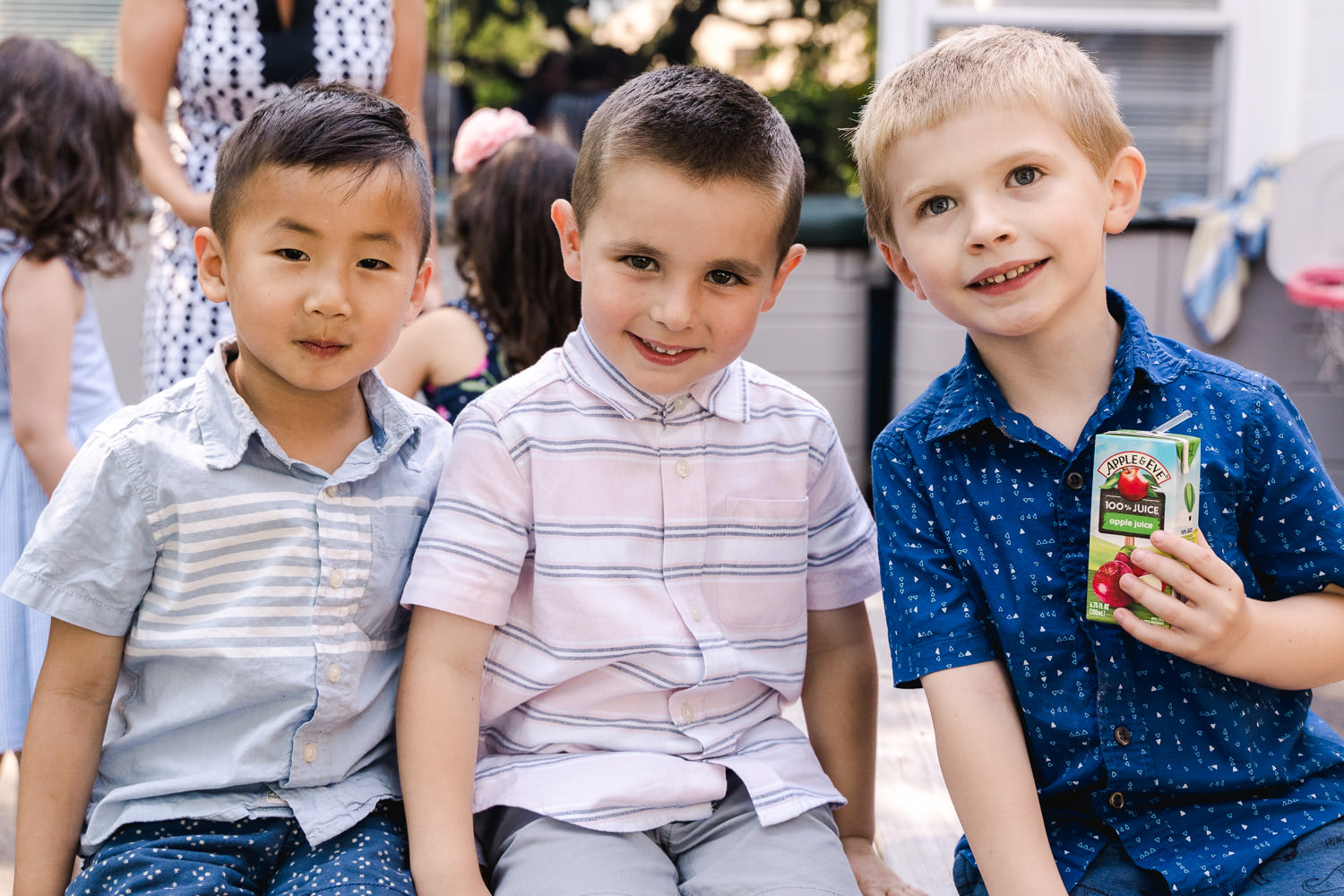 Friends smile together at their pre-K graduation party.