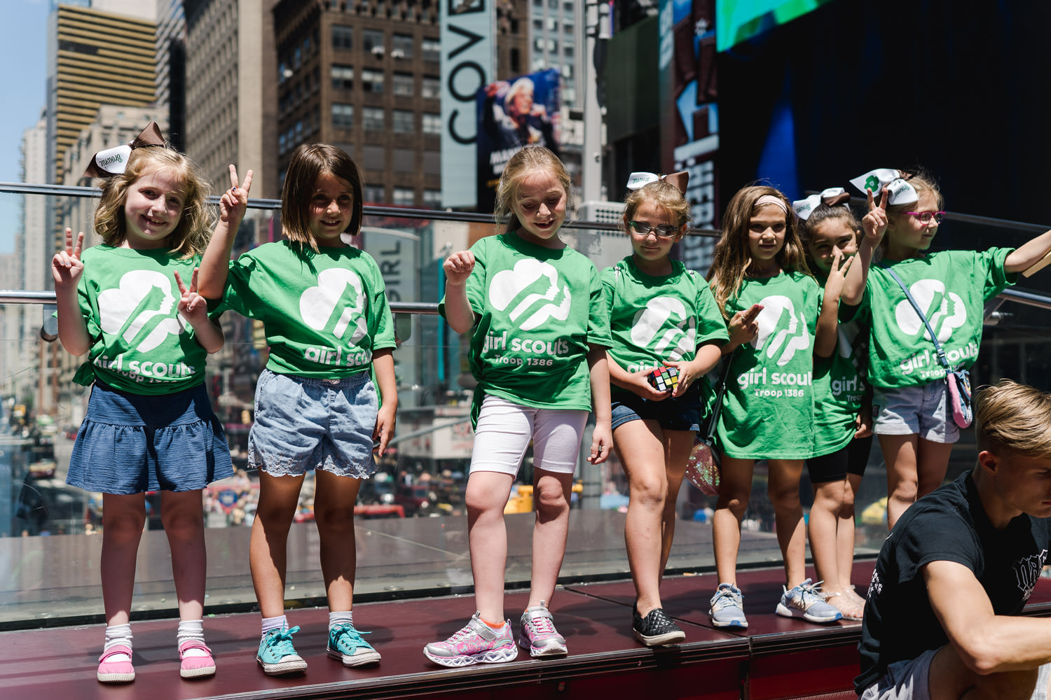 Girl Scouts pose together in Times Square.