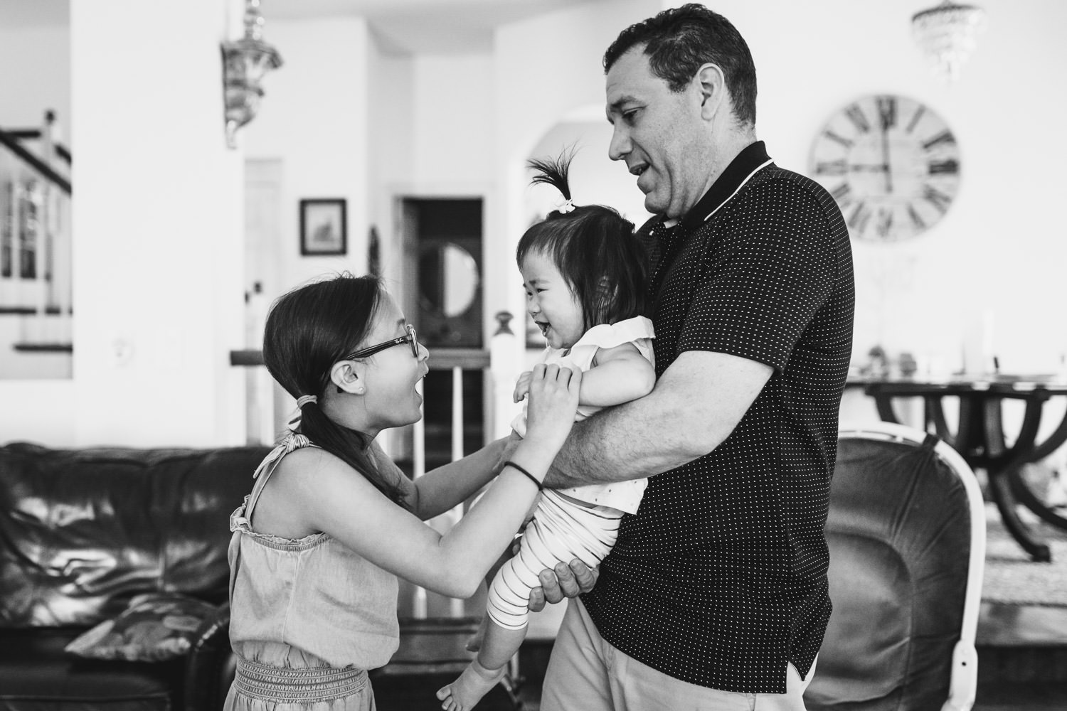 A father bonds with his two daughters.