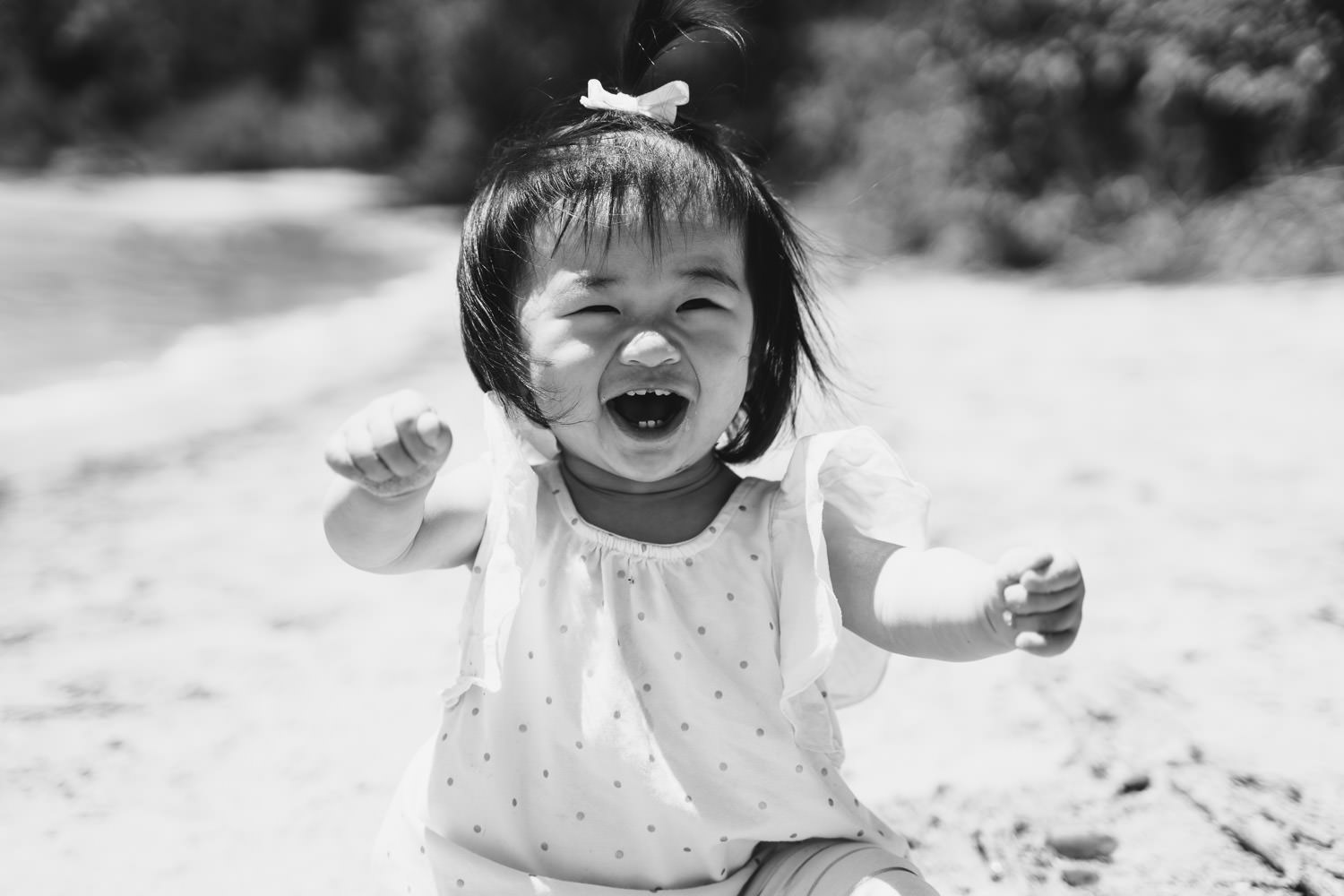 A smiling little girl at the beach.