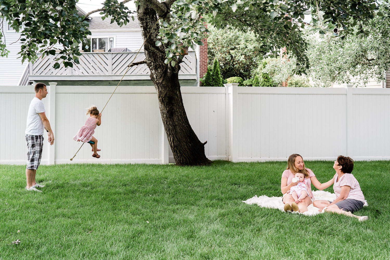 A family plays in their backyard.