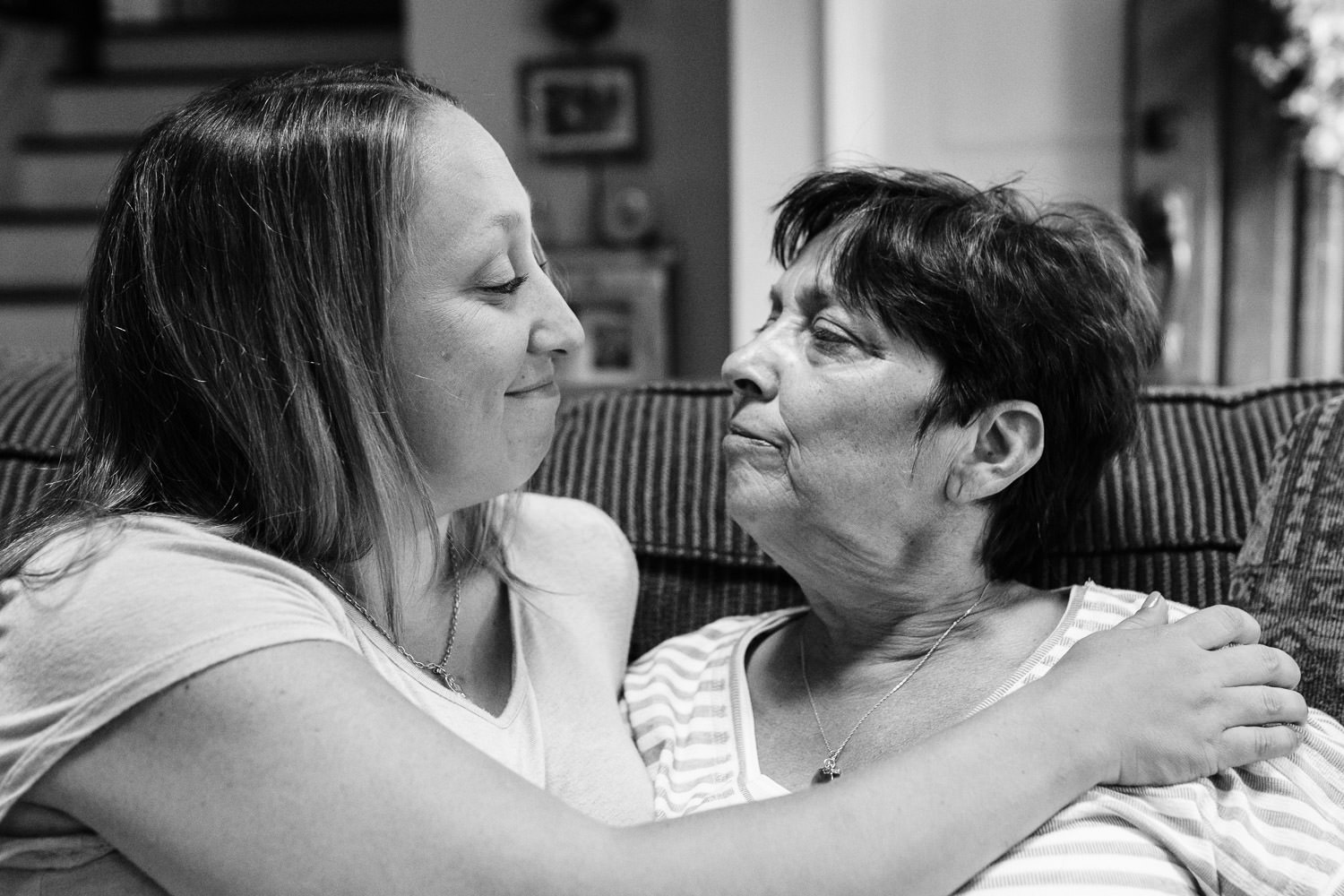 A mother and daughter look in each others' eyes.