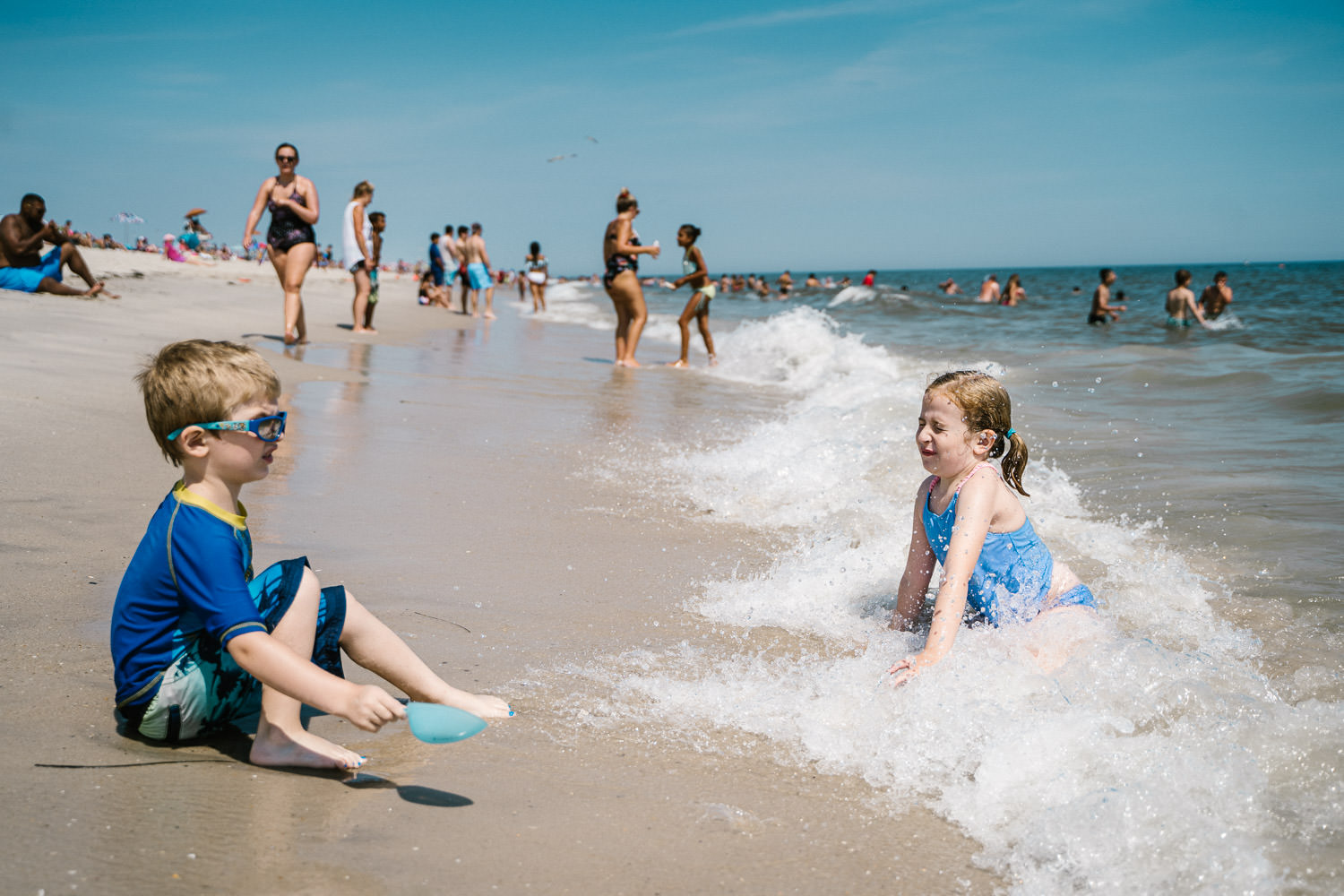 Two children play in the surf at Robert Moses beach.