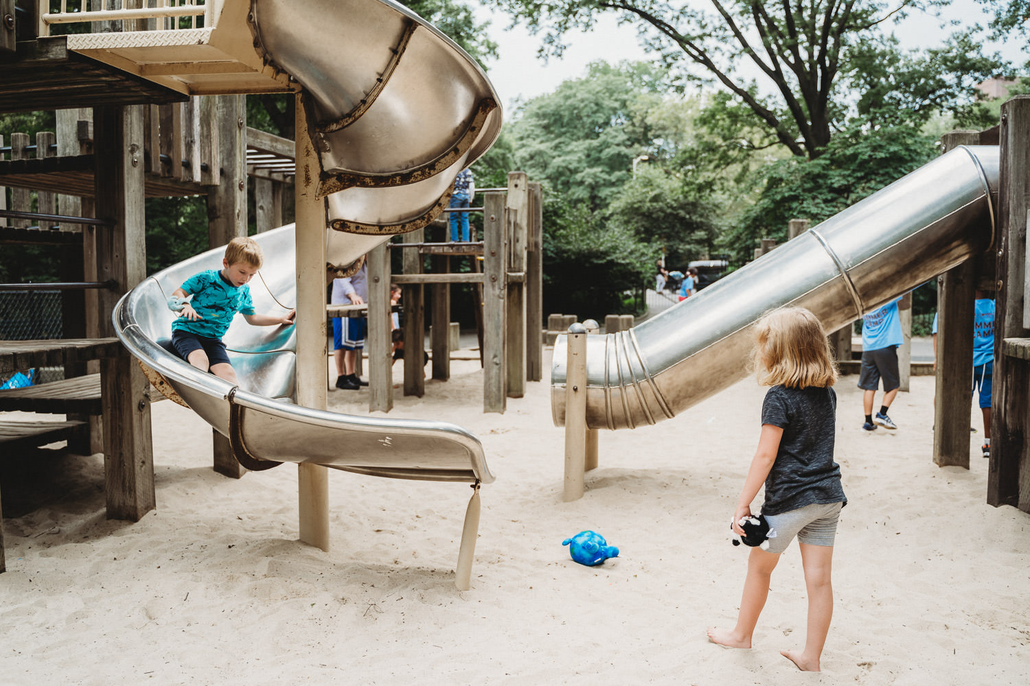 Two children play at the playground in Central Park.