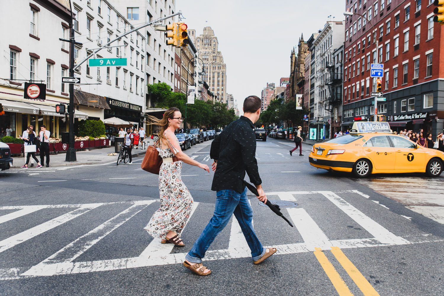 A couple crosses the street in Manhattan.