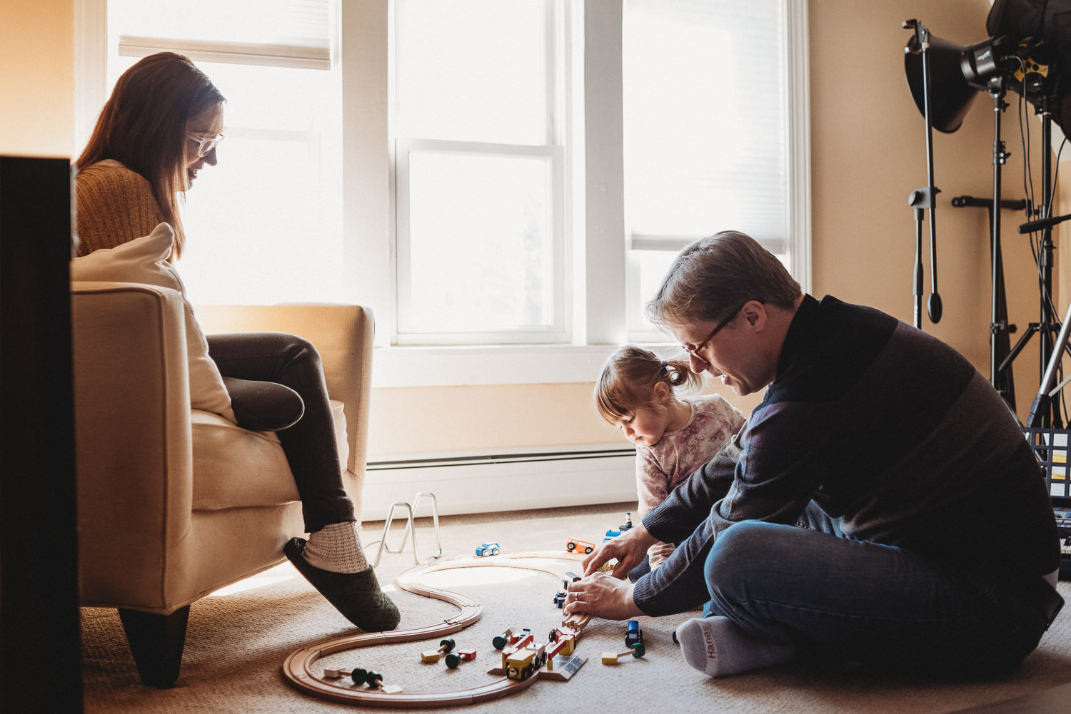 A family plays with a train set.