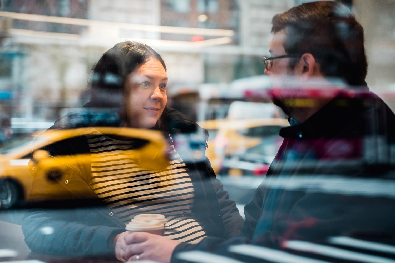 A couple sits inside a cafe.
