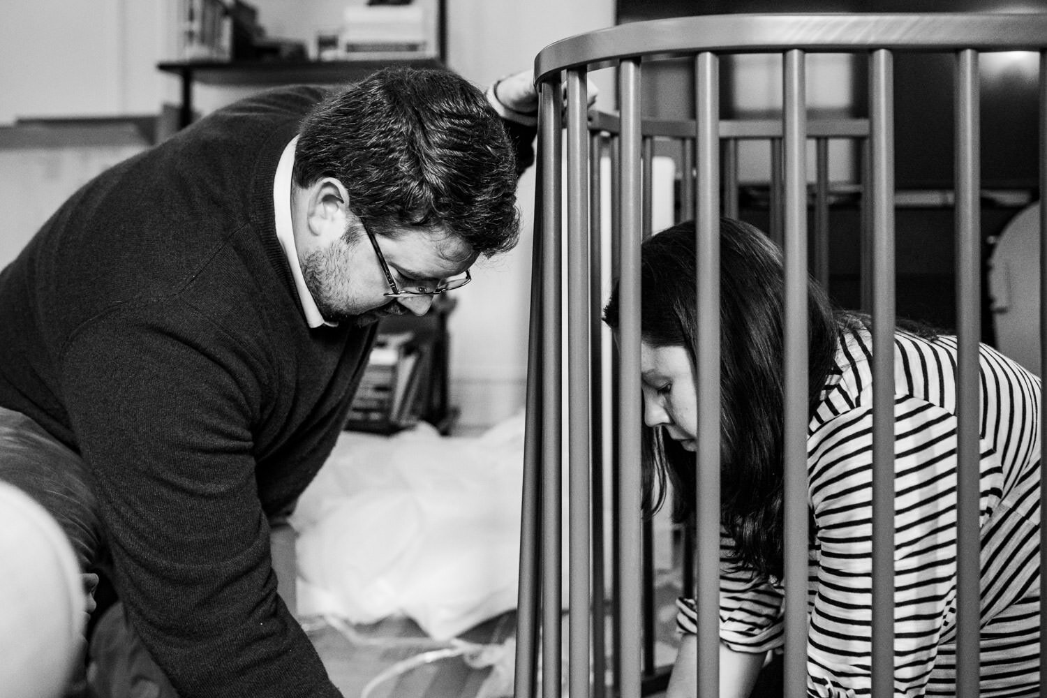A couple puts together a crib.