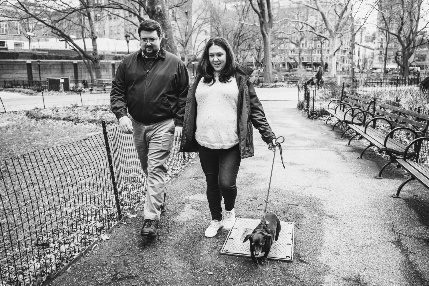 A couple walks their dog by the Natural History Museum.