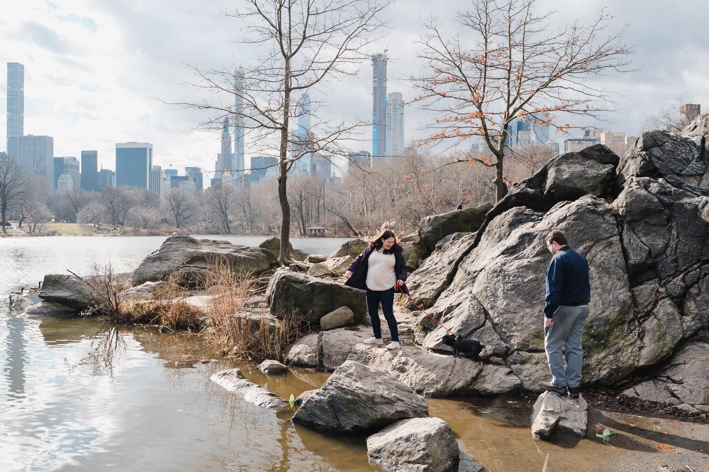 A couple climbs the rocks in Central Park.