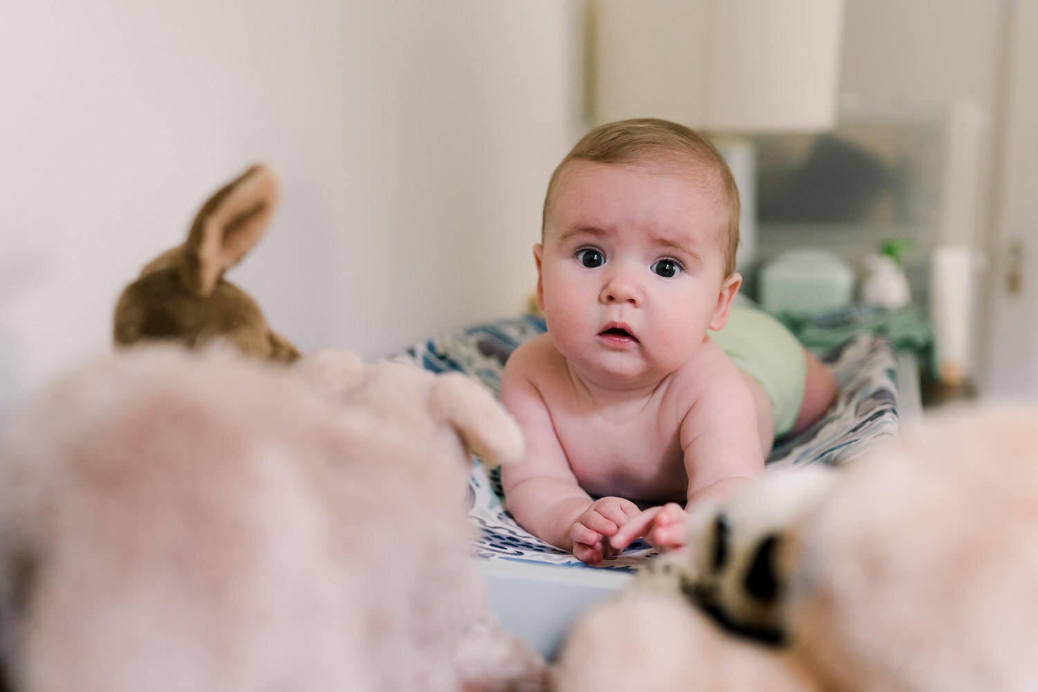 A baby lies on the changing table.