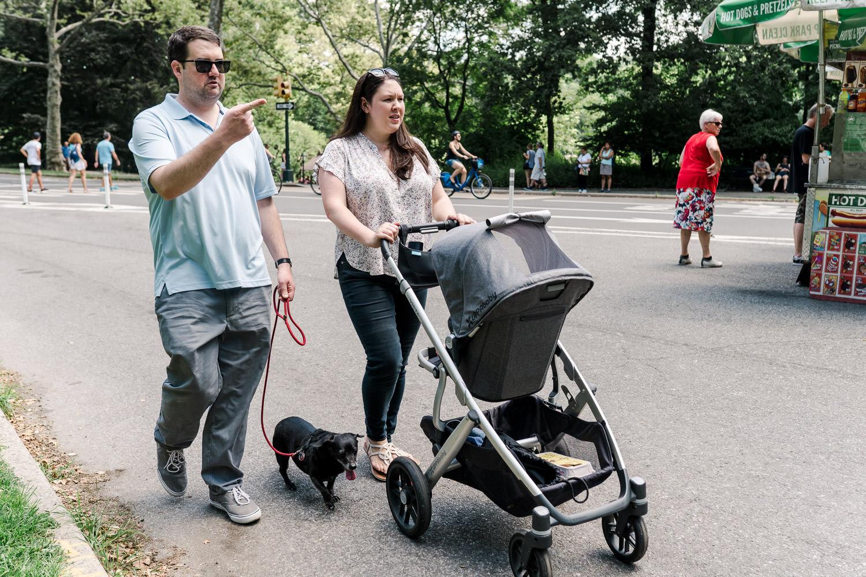 A family walks through Central Park.