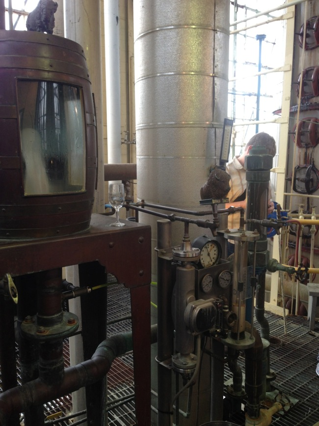 At the top of the still is the tasting box. Here the raw spirits can be sampled and viewed as they come off of the still to determine alcohol content and taste.