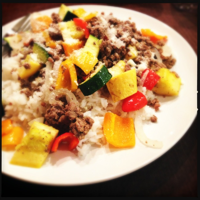 Summer squash, zucchini, and sweet bell peppers stir-fried with ground beef.  A nice, Light dinner.