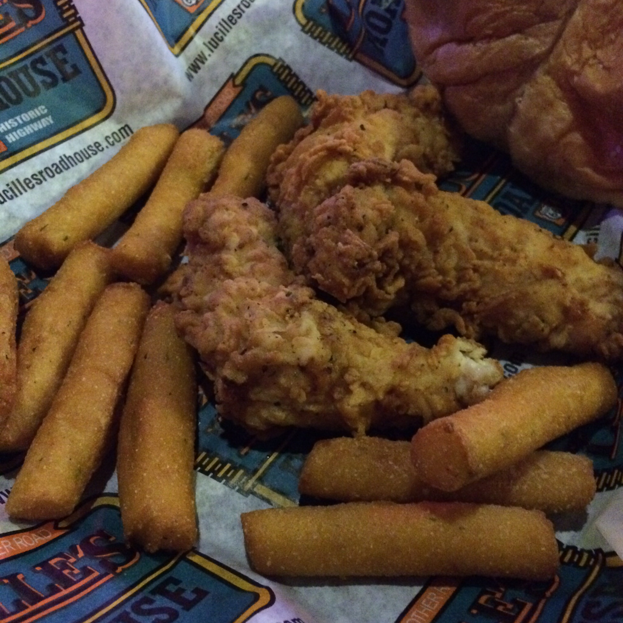 The half order of chicken fingers with hush puppies was 3 large pieces of chicken and 12 hush puppies.  A full meal anywhere but the Oklahoma\Texas area.