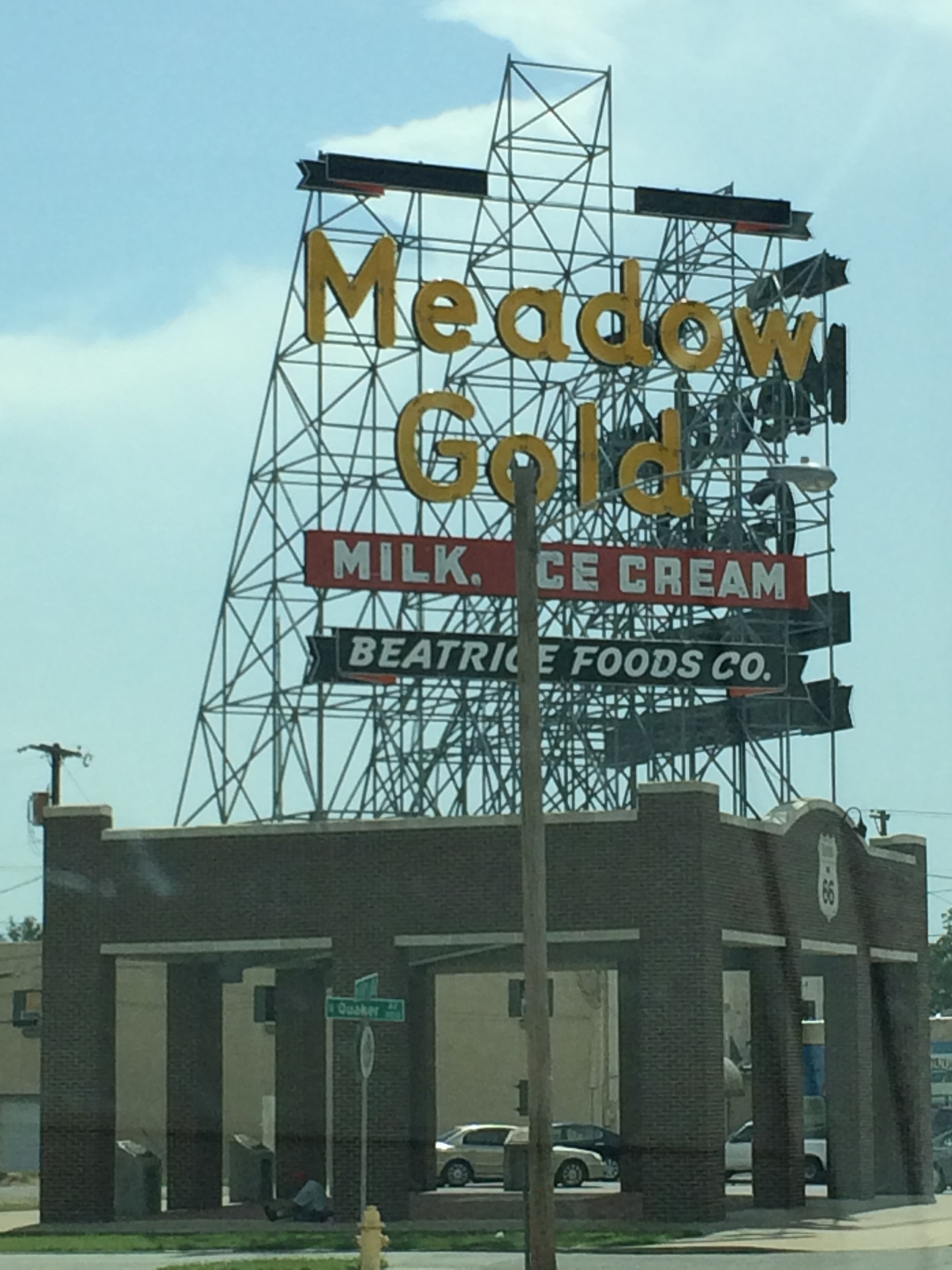 The Meadow Gold dairy goods sign in Tulsa now sits atop a pavilion with historical markers talking about the importance of the dairy to Tulsa instead of any of the remaining buildings from the plant.