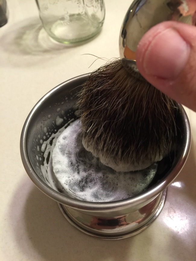 Step Four: Build a lather with your brush.  Start with as little water as you can and add water as needed to get lather to desired consistency.