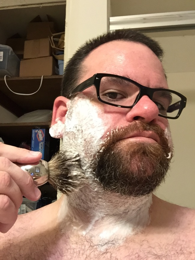 Step Five: Apply lather to beard.  Dab on, brushing with the grain.