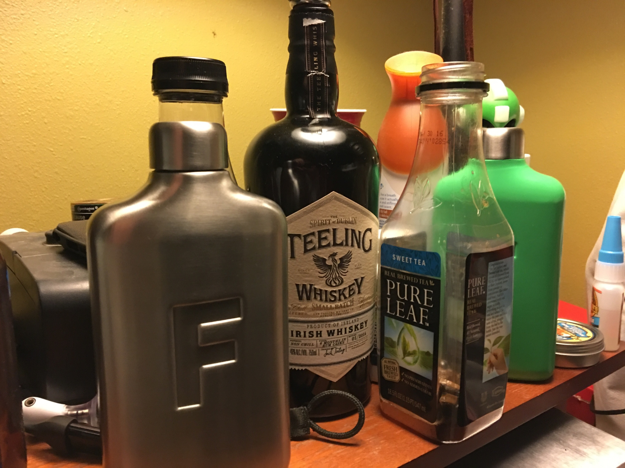 I know it looks like a problem, but the flasks in this picture are water bottles from FRED Flask.  Look for a full review of them soon.