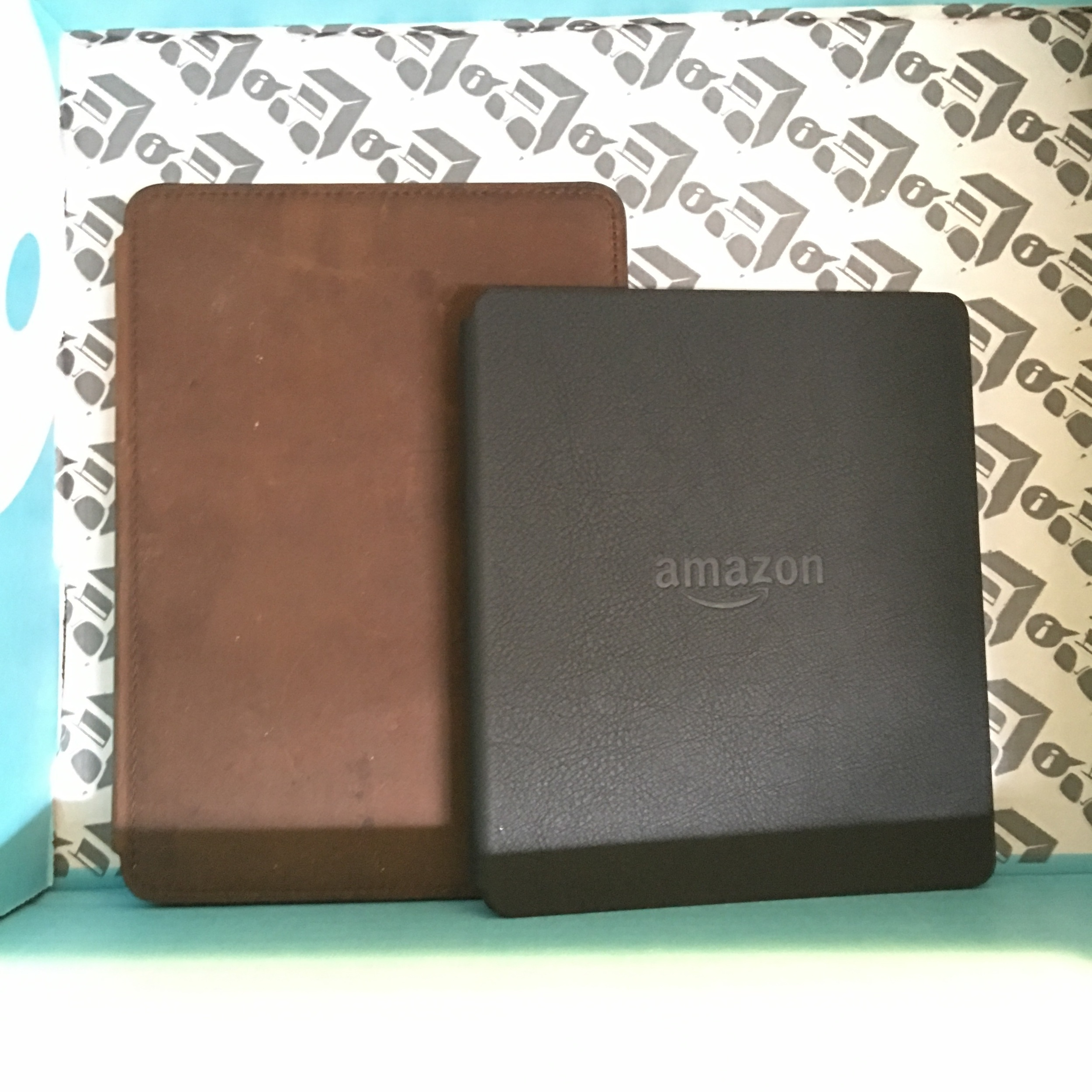 The 2015 Paperwhite in brown, new Oasis in black