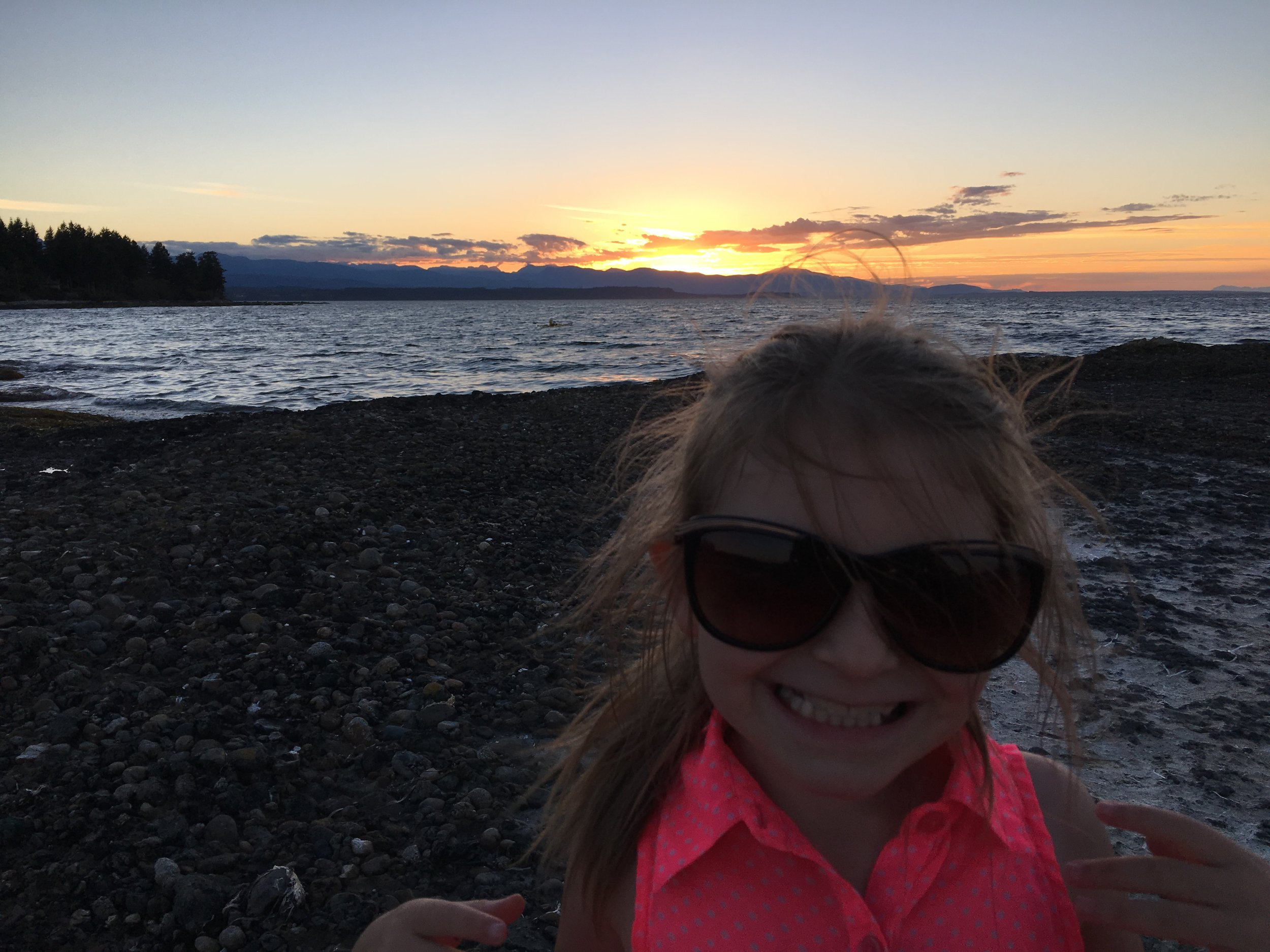My daughter loving the beach at sunset