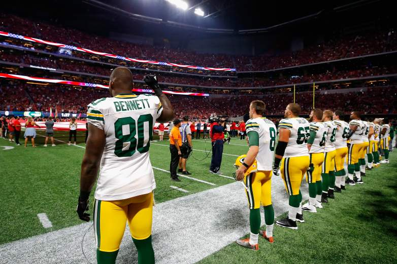 The Packers stood to honor the flag even as team President Mark Murphy was releasing a rebuttal to President Trumps remarks
