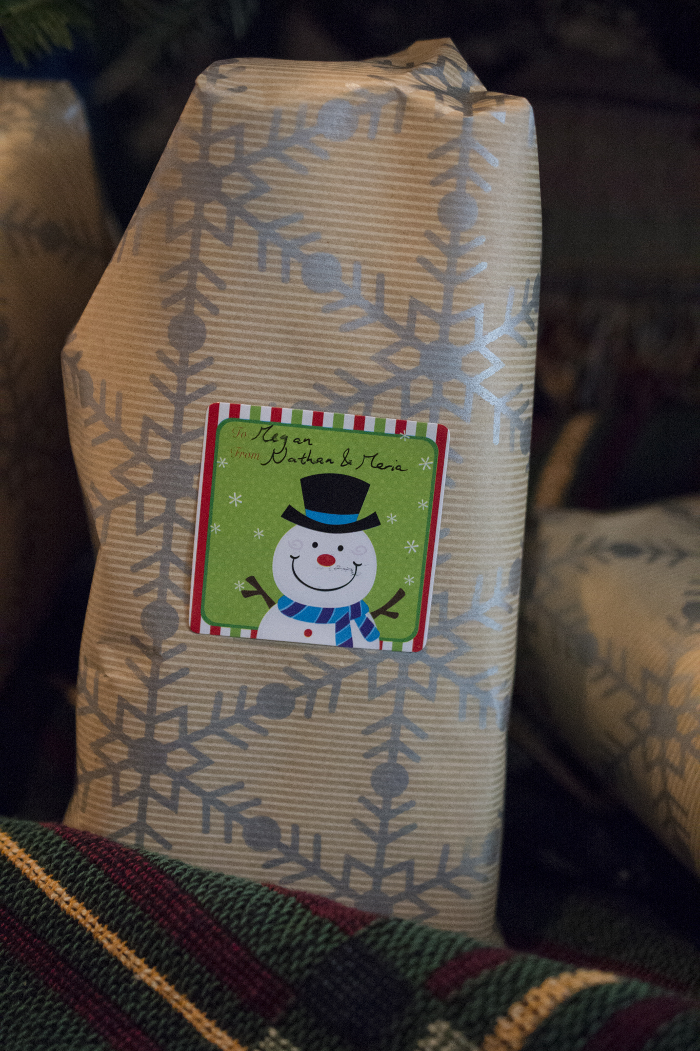Christmas gifts in snowflake wrapping paper