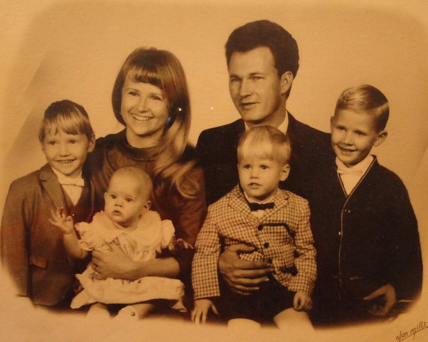 This is a picture of my mom (holding me), my dad, and my three brothers. Priceless!